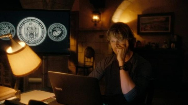 Deeks looking at pictures of Kensi & him...