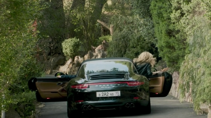 ...which Karposev and Anna manage to flee of in his oh-so-subtle Porsche.